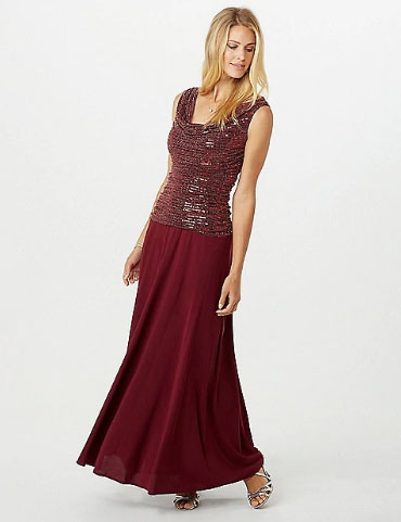 A Metallic Top Adds Sparkly Touch To This Gorgeous Gown Featuring Figure Flattering Ruching And Y Drape Neck Stop By